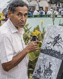 Artist painting on the street in Caracas Venezuela, portrait Royalty Free Stock Photography