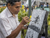 Artist painting on the street in Caracas Venezuela. Portrait. Stock Photo