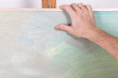 An artist painting in studio Royalty Free Stock Photography