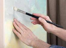An artist painting in studio Stock Photography