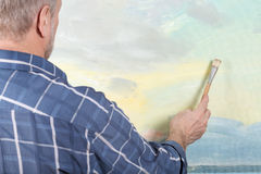 An artist painting in studio Royalty Free Stock Images