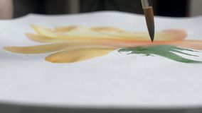 Artist painting watercolor paints on wet paper stock video footage