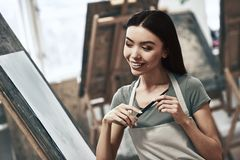 Artist painting. A young beautiful woman is a painting artist while working in a studio stock photos