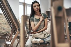 Artist painting. A young beautiful woman is a painting artist while working in a studio stock images