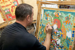 The artist paints a Buddhist icon Stock Images