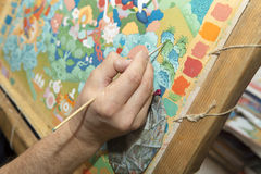The artist paints a Buddhist icon Stock Photos