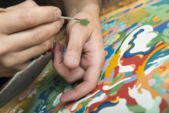 The artist paints a Buddhist icon Royalty Free Stock Photo