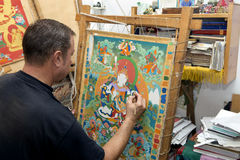 The artist paints a Buddhist icon Royalty Free Stock Photos