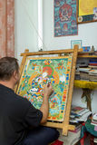 The artist paints a Buddhist icon Stock Image