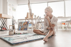 The artist paints on canvas Royalty Free Stock Image
