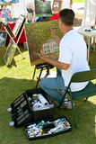 Artist Paints On Canvas At Outdoor Festival Stock Photo