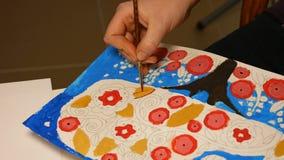 Artist paints child's watercolor picture artwork stock video