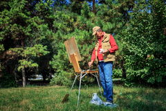 Artist. The artist paints in the city park of Almaty royalty free stock photography