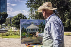 Artist. The artist paints in the city park of Almaty