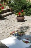Artist paints clay flowerpot Stock Image