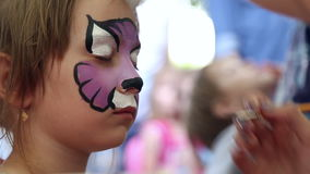 The artist paints face painting stock video