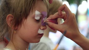 The artist paints face painting stock video footage