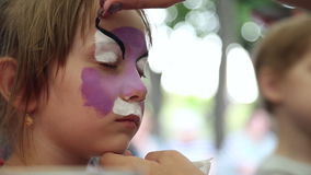 The artist paints face painting stock footage