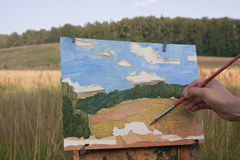 Artist paints landscape Stock Photos