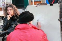 Artist paints monochromatic portrait Royalty Free Stock Photo