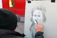 Artist paints monochromatic portrait of woman Royalty Free Stock Photos
