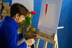 Artist paints with oil paints royalty free stock images