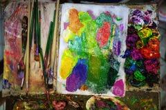 Artist paints oil palette.  royalty free stock image