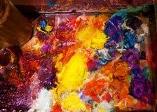 Artist paints oil palette.  royalty free stock photos
