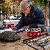 Artist paints outdoors on Market Street in San Francisco Royalty Free Stock Photos