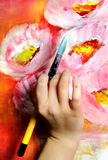 Artist paints a picture Stock Images