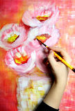 Artist paints a picture Stock Photo