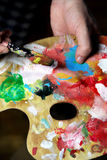 Artist paints a picture Stock Photography