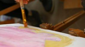 Artist paints picture artwork canvas in art studio stock video