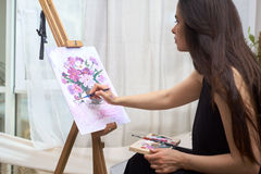 Artist paints picture on canvas Royalty Free Stock Photos