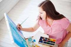 Artist paints picture on canvas Royalty Free Stock Photography