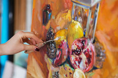 artist paints a picture of oil paint with palette-knife closeup stock images