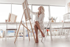 The artist paints a picture. Stock Images