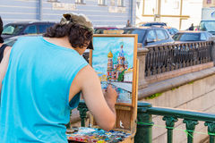 The artist paints the temple of the Savior on the Blood stock photo