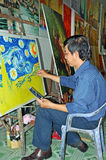 Artist Paints Van Gogh Reproduction in HCMC. Royalty Free Stock Photography