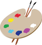 Artist Palette. An artist's palette with two paintbrushes Stock Photo