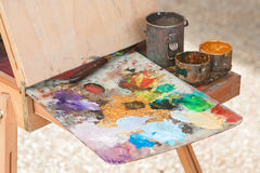 Artist Palette Covered With Oil Paints Sits Ready On Easel Royalty Free Stock Images