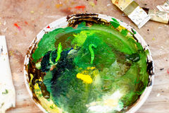 Artist palette with different shades of green oil colours. Royalty Free Stock Image