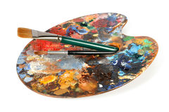 Artist Palette With paintbrushes royalty free stock image