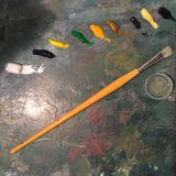 Artist pallet. Painting colors colors oil paint yellow paintbrush royalty free stock photo