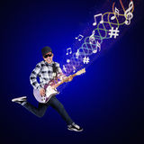 Artist perform guitar on blue background Royalty Free Stock Images