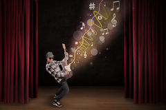 Artist perform with guitar on stage Royalty Free Stock Photography