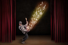 Artist perform guiter instrument on stage Royalty Free Stock Photography