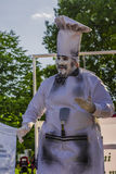 Artist performing in chef costume. Artist dressed as a cooking chef and performing in an open air event at International Festival of Living Statues on May 30 Royalty Free Stock Photo