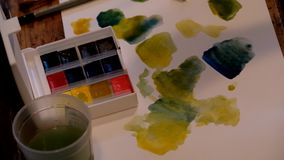 Artist picks up the paint stock footage