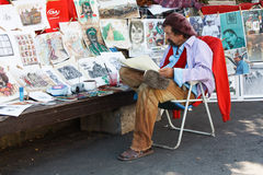 The artist placed in the town square and draws caricatures of people. Stock Photos